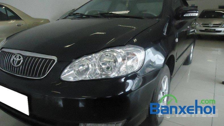 Xe Toyota Corolla J 2003 cũ màu đen đang được bán với giá 285000000 vnd-2