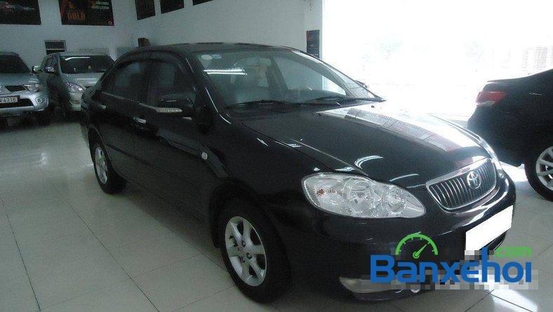 Xe Toyota Corolla J 2003 cũ màu đen đang được bán với giá 285000000 vnd-1