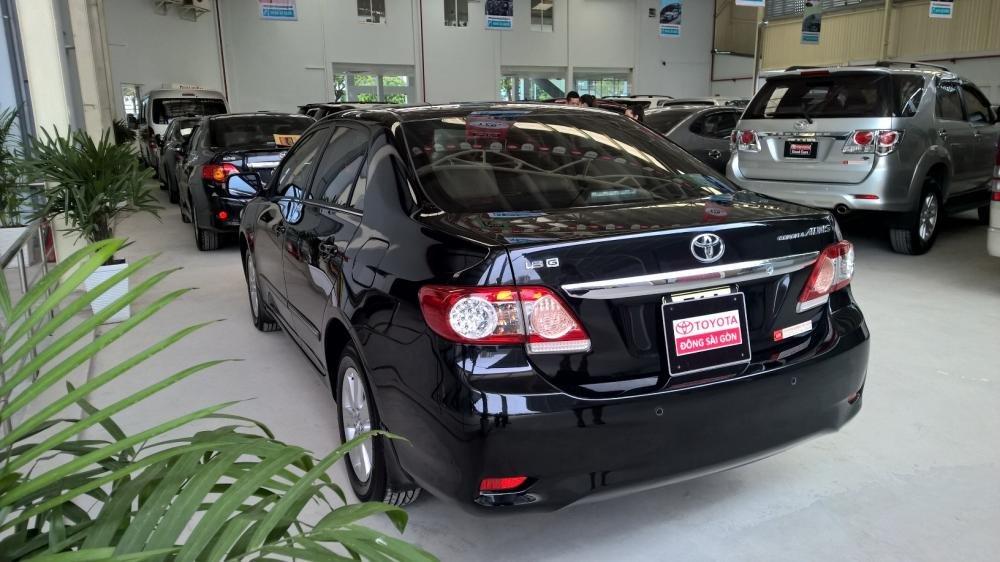 Bán xe Toyota Corolla 1.8MT đời 2012, màu đen, xe nhập  -3