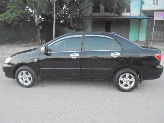 Gia đình cần bán xe Corolla Altis 1.8 số tay 2003 chính chủ mầu đen-1