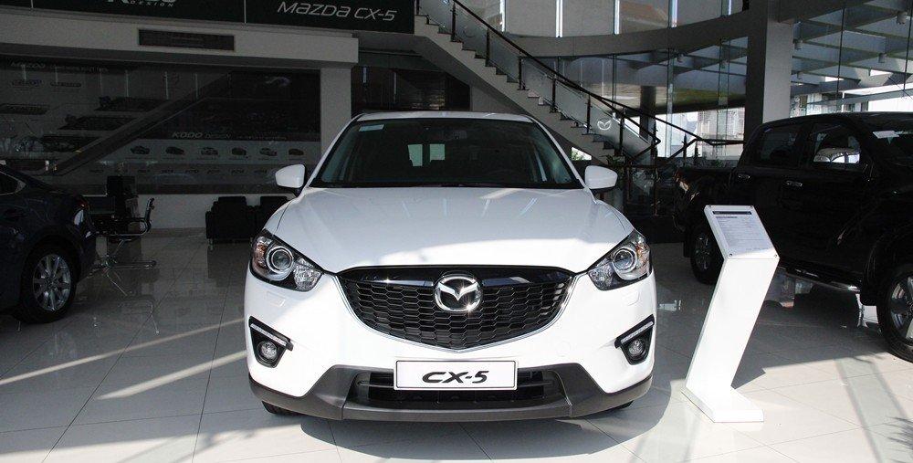So sánh đầu xe Kia Sportage 2016 và Mazda CX-5.