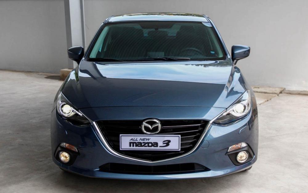 So sánh nhanh Mazda 3 sedan 2015 và Kia K3 2013 về phần đầu xe.