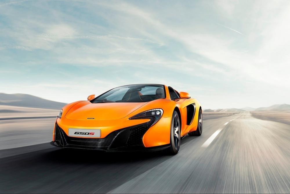 Đánh giá xe McLaren 650S Spider có rất nhiều điểm nhấn vuốt cong cực kỳ ấn tượng.