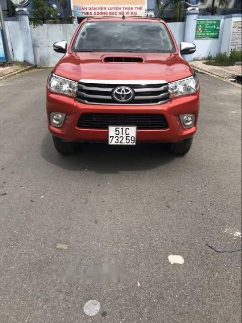 Bán ô tô Toyota Hilux 2.5E năm 2016, màu đỏ, xe nhập số sàn (1)