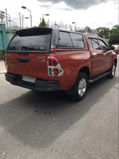 Bán ô tô Toyota Hilux 2.5E năm 2016, màu đỏ, xe nhập số sàn (3)
