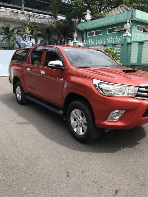 Bán ô tô Toyota Hilux 2.5E năm 2016, màu đỏ, xe nhập số sàn (2)