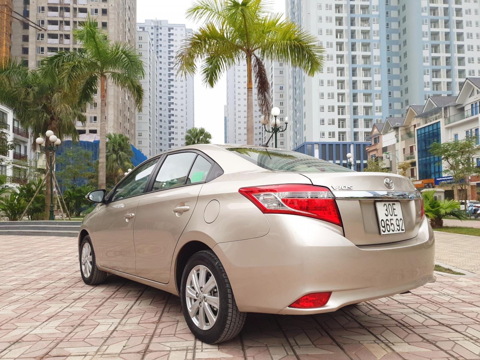 Bán Toyota Vios 1.5G AT đời 2017, màu vàng (11)