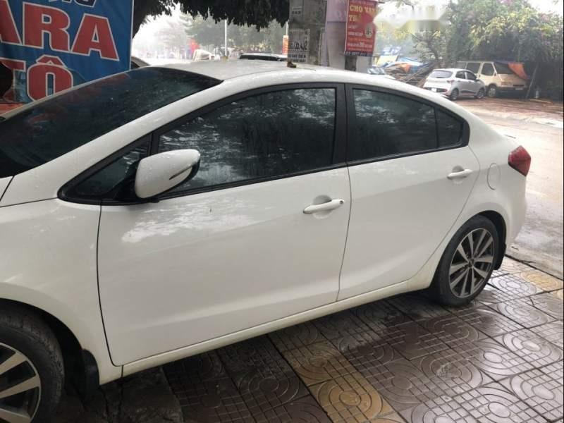 Cần bán gấp Kia K3 2015, màu trắng, xe nhập còn mới, giá tốt (3)