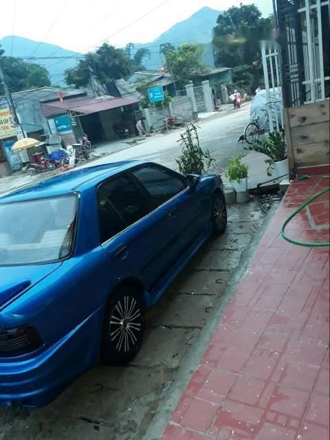 Cần bán Mazda 323 năm sản xuất 1995, màu xanh lam (3)