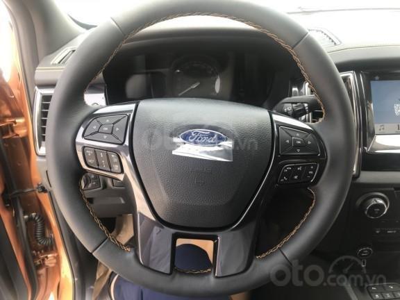 Ford Ranger 2019 được trang bị vô lăng bọc da 3 chấu, tích hợp nhiều nút bấm chức năng a1
