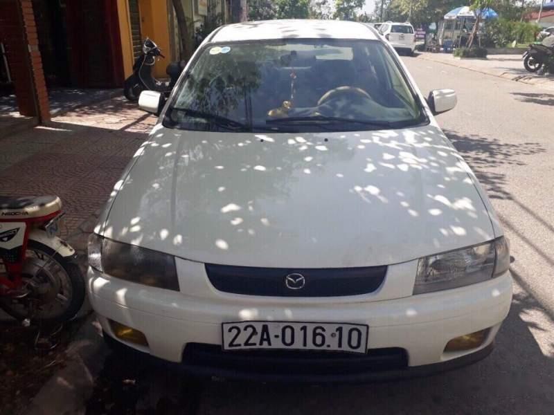 Bán xe Mazda 323 2000, màu trắng, 95tr-0