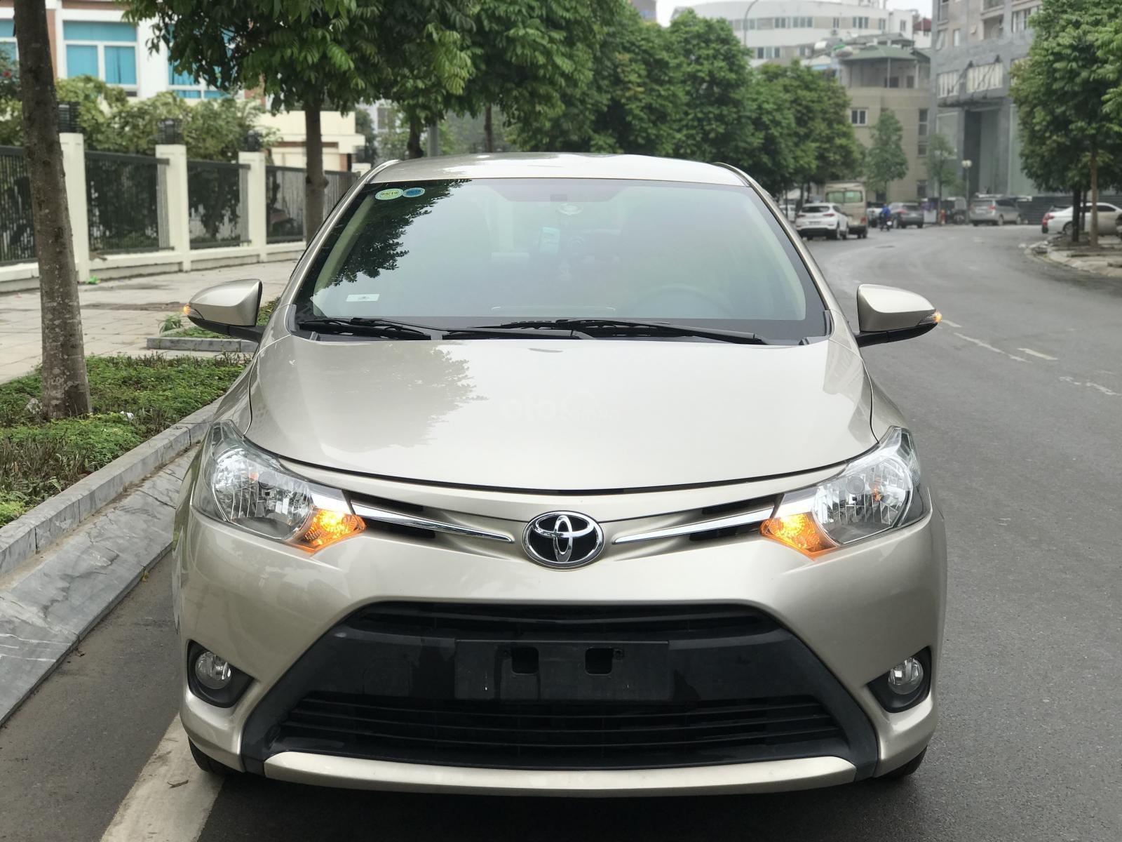 Bán xe Toyota Vios E CVT 2017, màu vàng, tại Hà Nội-0