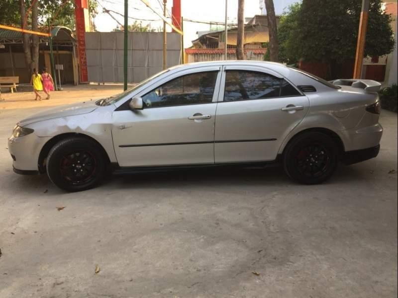 Cần bán xe Mazda 6 năm 2004, màu bạc còn mới, 240 triệu (1)