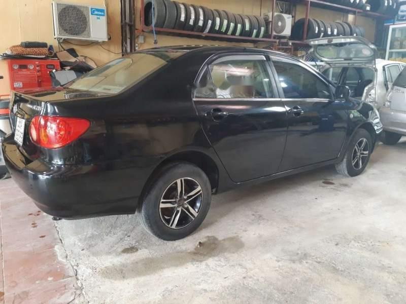 Bán ô tô Toyota Corolla Altis 1.8 MT đời 2002, màu đen xe gia đình-1