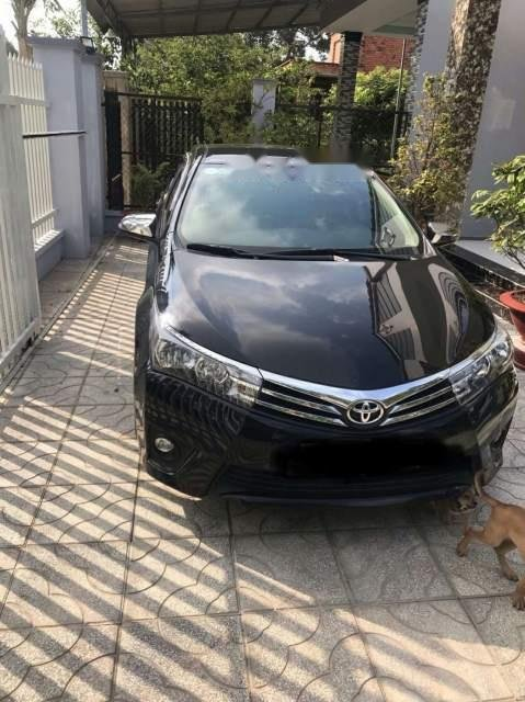 Bán Toyota Corolla altis 1.8MT 2017, màu đen xe gia đình-1