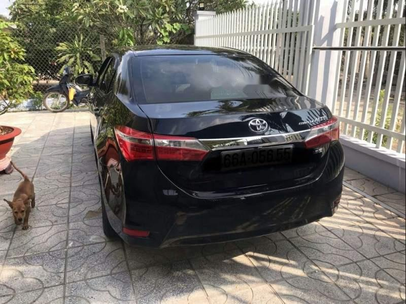 Bán Toyota Corolla altis 1.8MT 2017, màu đen xe gia đình-4