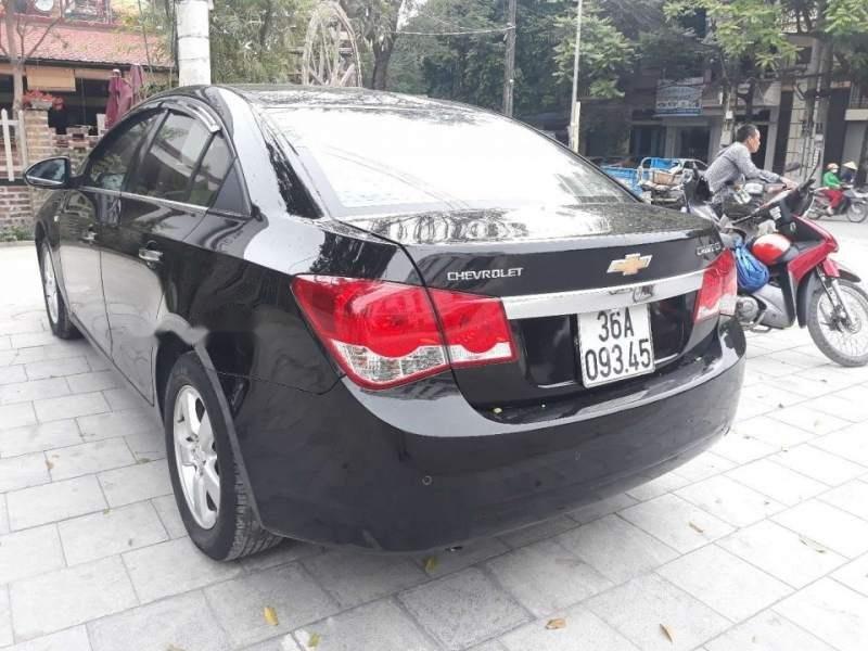 Cần bán Chevrolet Cruze sản xuất 2014, màu đen còn mới (3)