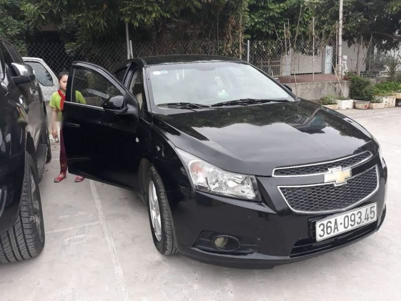 Cần bán Chevrolet Cruze sản xuất 2014, màu đen còn mới (2)