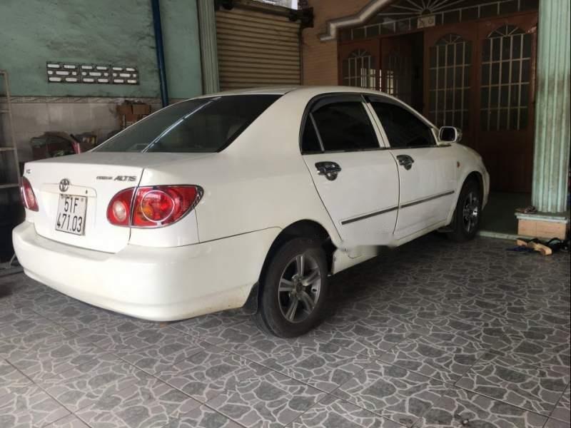 Bán xe Toyota Corolla altis đời 2003, màu trắng, xe nhập số sàn-0