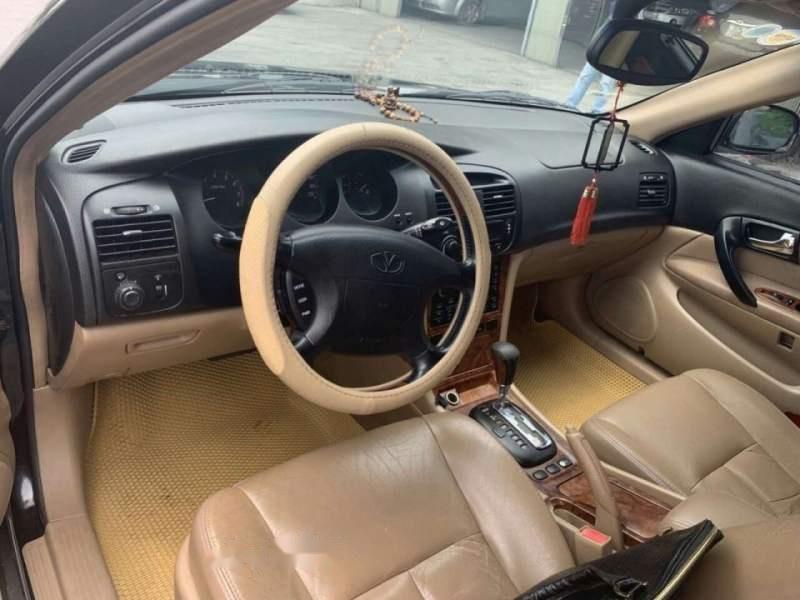 Bán xe Daewoo Magnus đời 2004, màu đen số tự động, giá chỉ 137 triệu-3