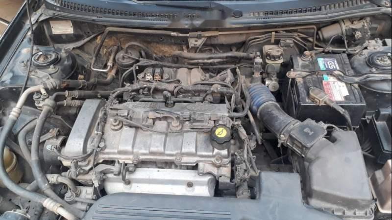 Bán Ford Laser 2004, màu đen, xe nhập, xe gia đình -2