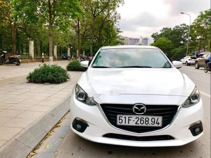 Bán xe Mazda 3 1.5AT đời 2015, màu trắng (1)
