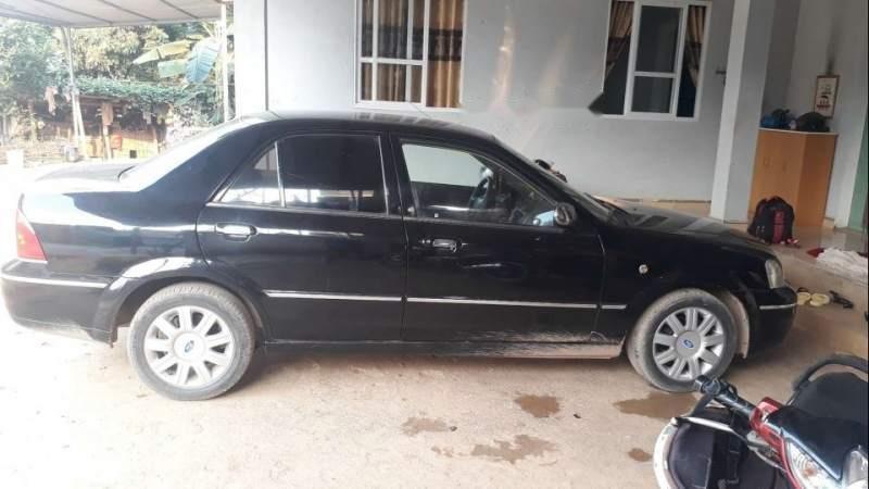 Bán Ford Laser 2004, màu đen, xe nhập, xe gia đình -1
