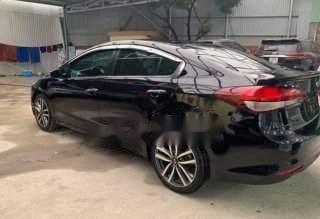 Cần bán xe Kia Cerato sản xuất năm 2016, màu đen-0