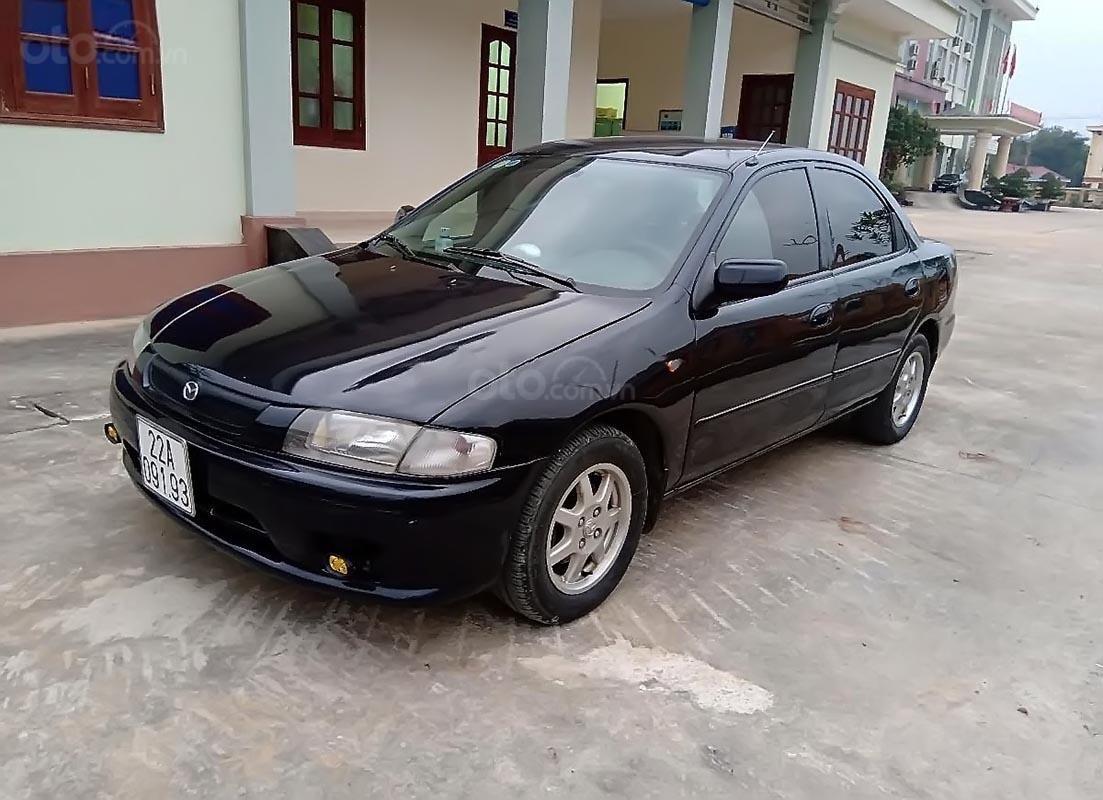 Bán Mazda 323 2000, còn tương đối nguyên bản, màu xanh đen quyền lực (1)