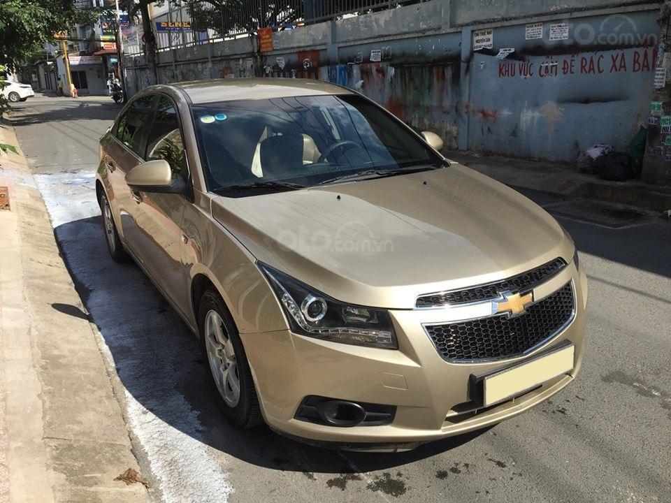 Bán Chevrolet Cruze LS 2011 số sàn ,màu vàng cát, gia đình chính chủ-1