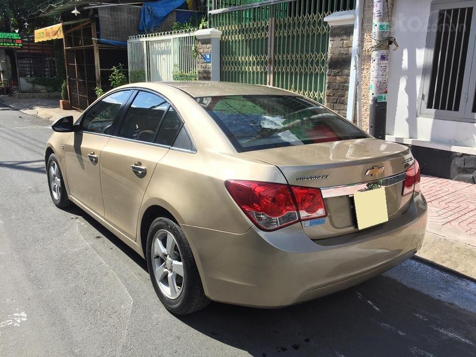 Bán Chevrolet Cruze LS 2011 số sàn ,màu vàng cát, gia đình chính chủ-2