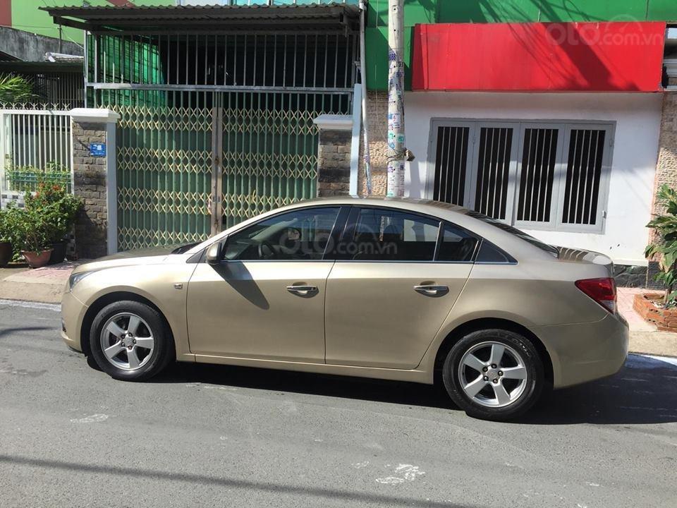 Bán Chevrolet Cruze LS 2011 số sàn ,màu vàng cát, gia đình chính chủ-9