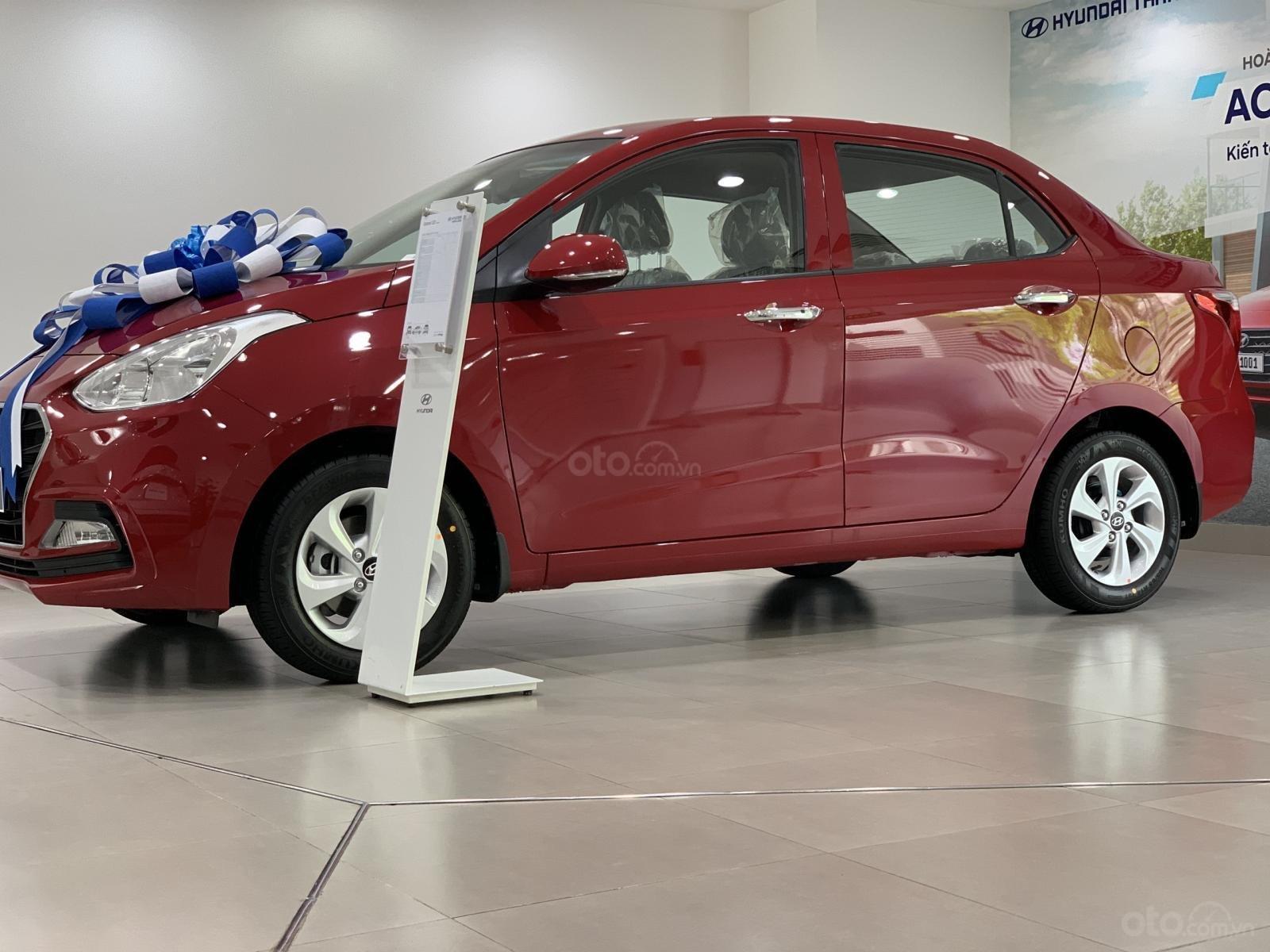 Hyundai Grand i10 sedan MT đỏ nhận xe ngay chỉ với 130tr, hỗ trợ đăng ký Grab, tặng bộ PK cao cấp, hỗ trợ vay trả góp (1)
