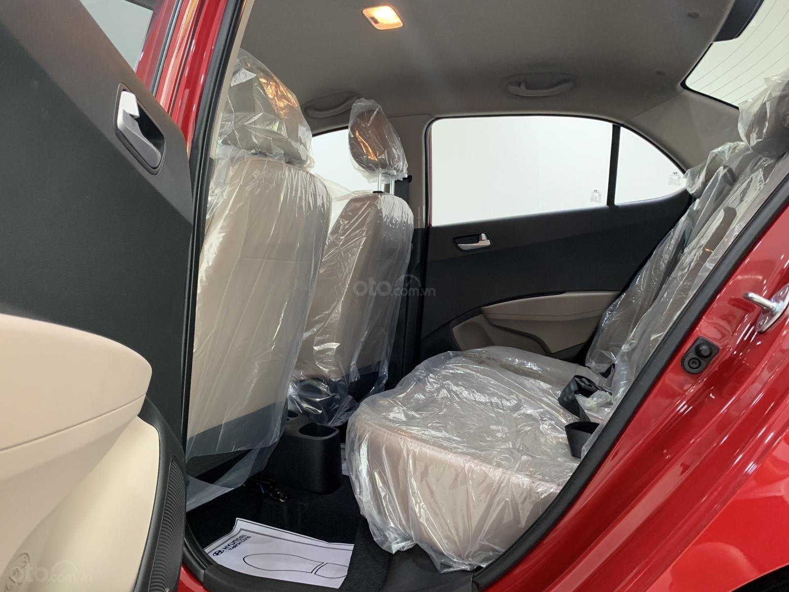Hyundai Grand i10 sedan MT đỏ nhận xe ngay chỉ với 130tr, hỗ trợ đăng ký Grab, tặng bộ PK cao cấp, hỗ trợ vay trả góp (7)