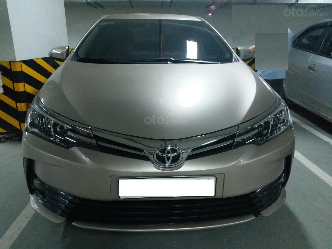 Bán Toyota Corolla Altis 1.8E AT màu vàng, sản xuất và đăng ký 12/2018, biển Hà Nội-0