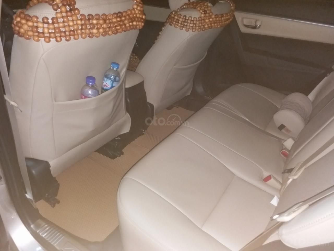 Bán Toyota Corolla Altis 1.8E AT màu vàng, sản xuất và đăng ký 12/2018, biển Hà Nội-7