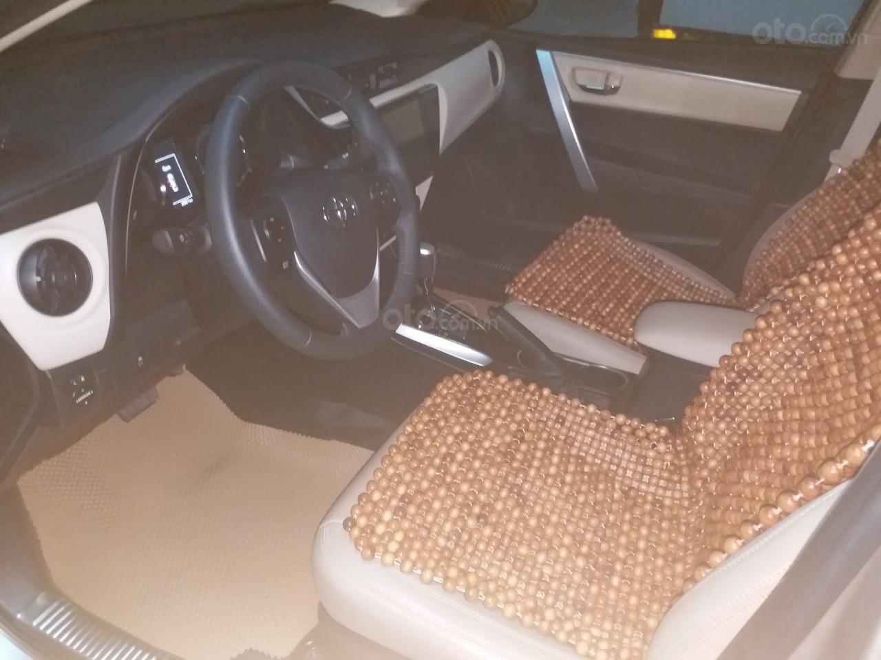 Bán Toyota Corolla Altis 1.8E AT màu vàng, sản xuất và đăng ký 12/2018, biển Hà Nội-4