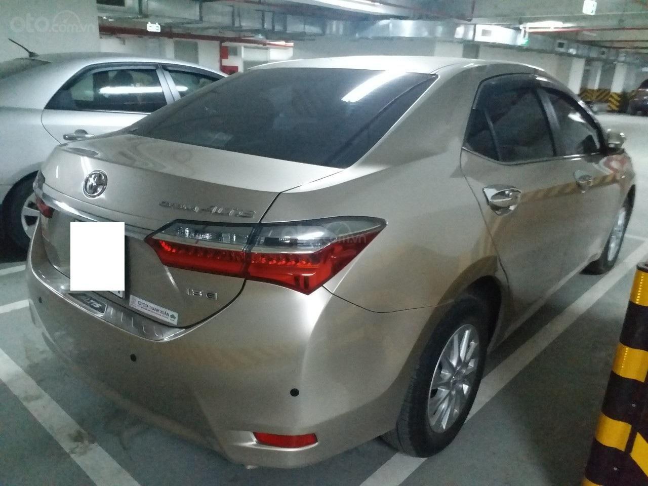 Bán Toyota Corolla Altis 1.8E AT màu vàng, sản xuất và đăng ký 12/2018, biển Hà Nội-15