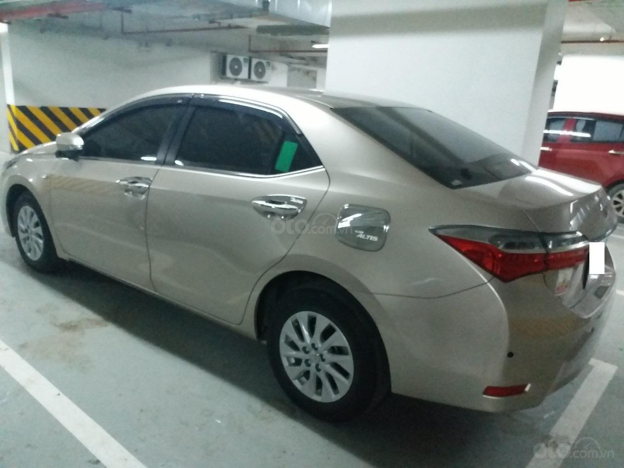 Bán Toyota Corolla Altis 1.8E AT màu vàng, sản xuất và đăng ký 12/2018, biển Hà Nội-14
