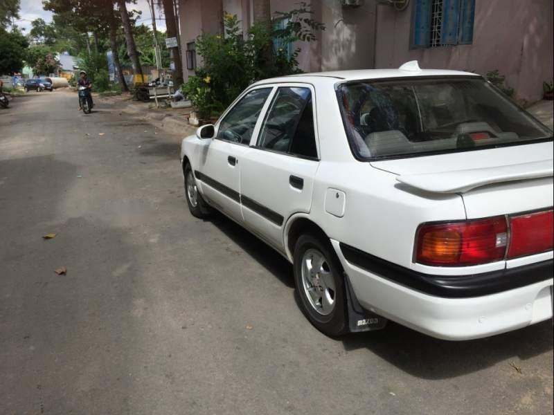 Bán ô tô Mazda 323 đời 1995, màu trắng, nhập khẩu nguyên chiếc-4
