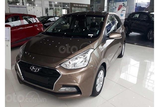 Hyundai Grand I10 1.2 MT vàng cát giao ngay, hỗ trợ đăng ký Grab, hỗ trợ vay trả góp lãi suất ưu đãi. LH: 0977 139 312 (1)