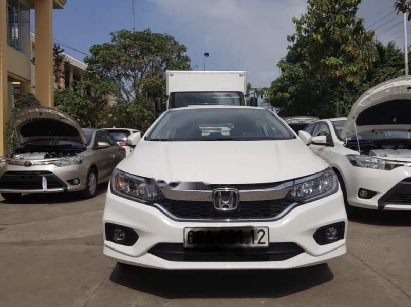 Cần bán lại xe Honda City 2017, màu trắng còn mới, giá chỉ 530 triệu-1