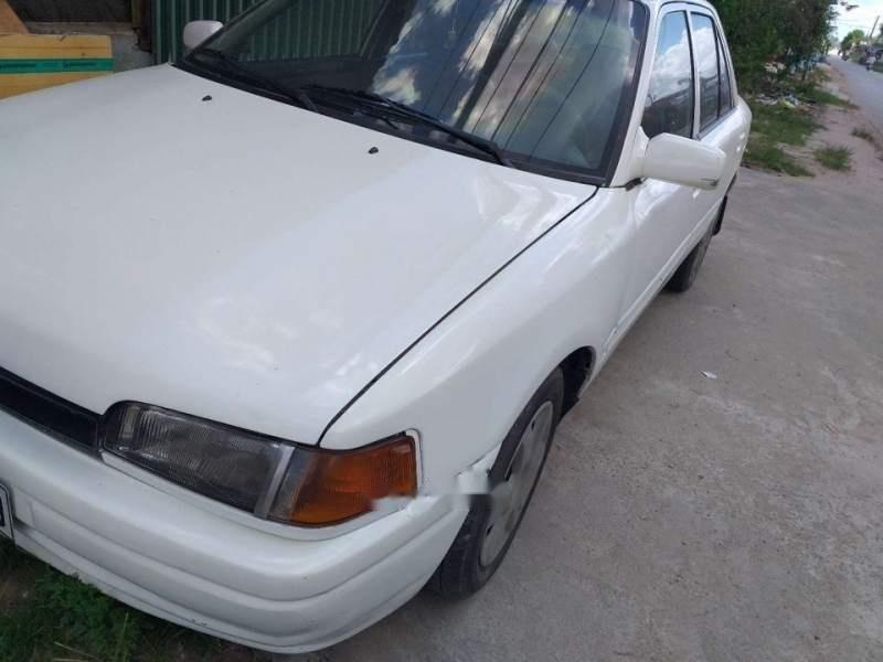 Cần bán xe Mazda 323 sản xuất năm 1994, màu trắng, nhập khẩu nguyên chiếc, 55 triệu-1