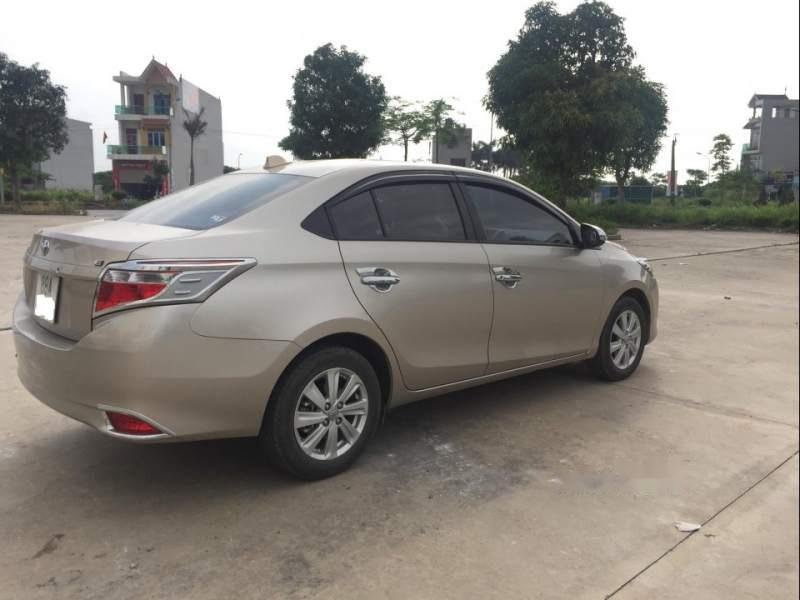 Bán Toyota Vios 1.5E MT đời 2018, màu vàng xe gia đình-1
