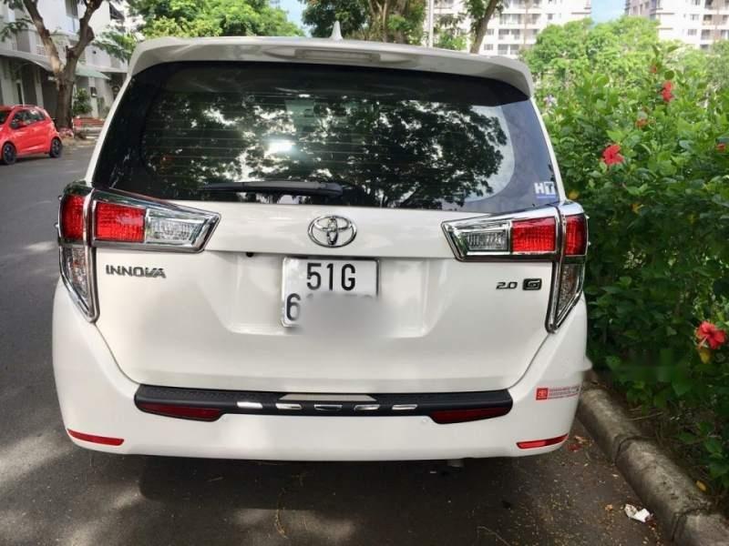 Cần bán Toyota Innova G đời 2018, màu trắng xe gia đình (6)