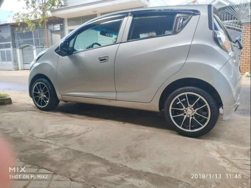 Gia đình bán xe Chevrolet Spark 1.2 LS năm sản xuất 2013, màu bạc-0