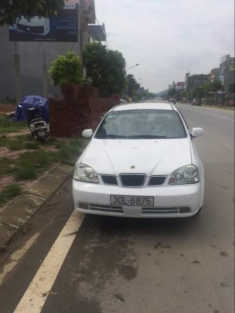 Bán lại xe Daewoo Lacetti sản xuất 2005, màu trắng, xe nhập xe gia đình (1)