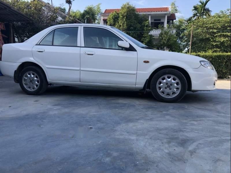 Gia đình bán xe Mazda 323 năm 2001, màu trắng, giá chỉ 155 triệu (1)