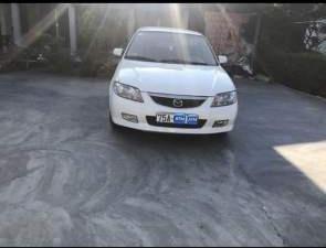 Gia đình bán xe Mazda 323 năm 2001, màu trắng, giá chỉ 155 triệu (6)