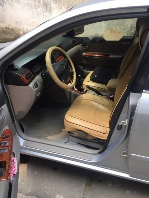 Bán Toyota Corolla Altis 1.8G MT đời 2002, màu bạc, xe nguyên bản công chức đi rất ít-3
